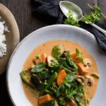 coconut curry soup with bowl of rice