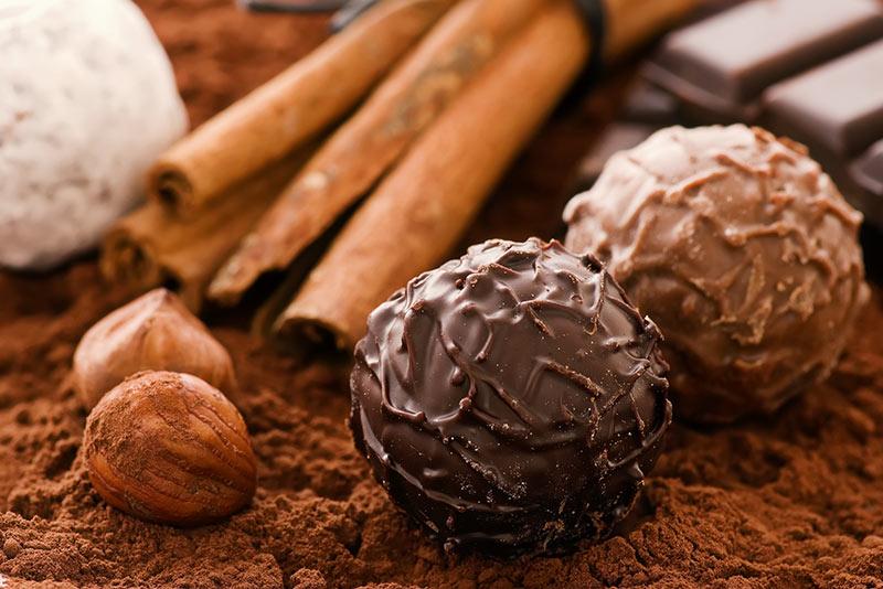 chocolate truffles next to cinnamon sticks