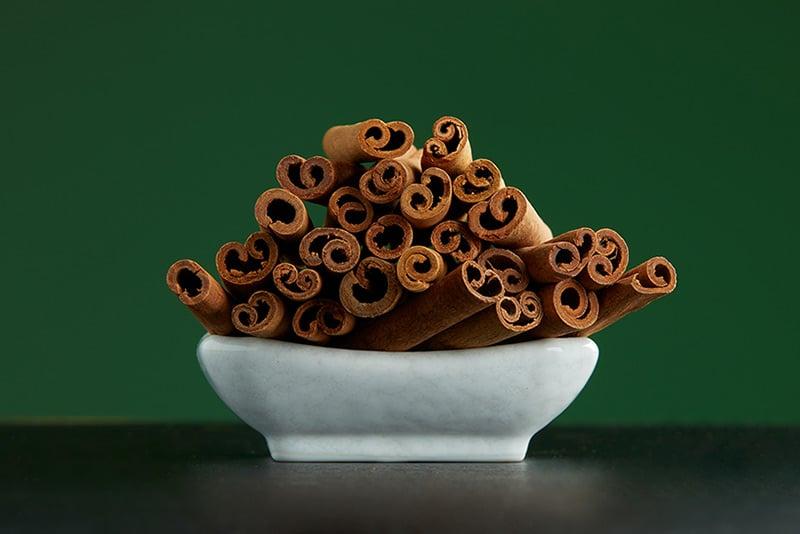 Cassia cinnamon sticks in bowl